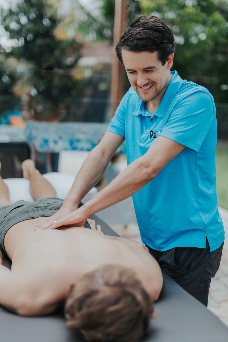 Jacob from MyPlace Physio Coolangatta treating a back pain patient